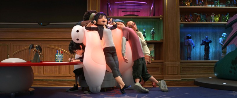Hiro & the team huddle for warmth with Baymax in Big Hero 6